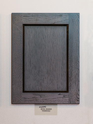 A hickory kitchen cabinet door, in the Charcoal finish