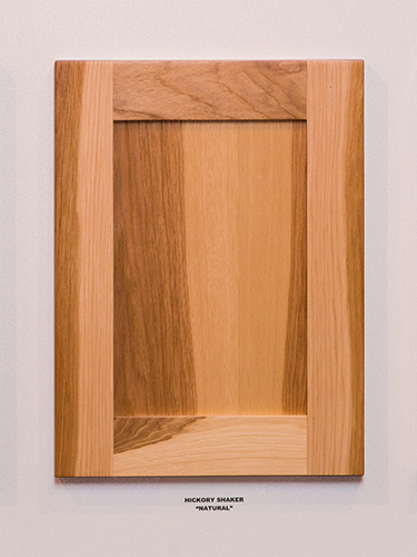 A hickory kitchen cabinet door, in the Natural finish