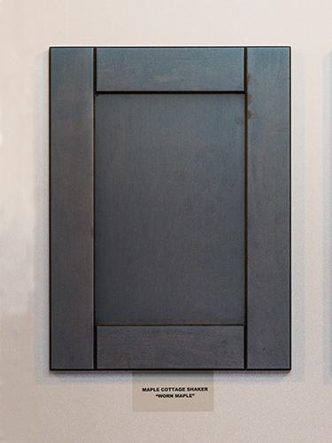 A maple kitchen cabinet door, in the Worn Maple finish