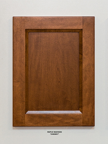 A maple kitchen cabinet door, in the Cherry finish