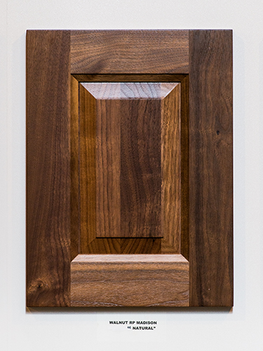 A walnut kitchen cabinet door, in the Natural finish