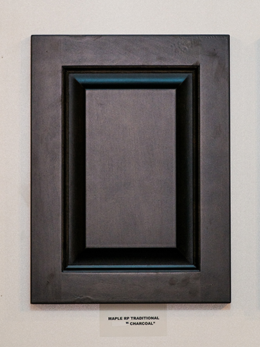 A maple kitchen cabinet door, in the Charcoal finish