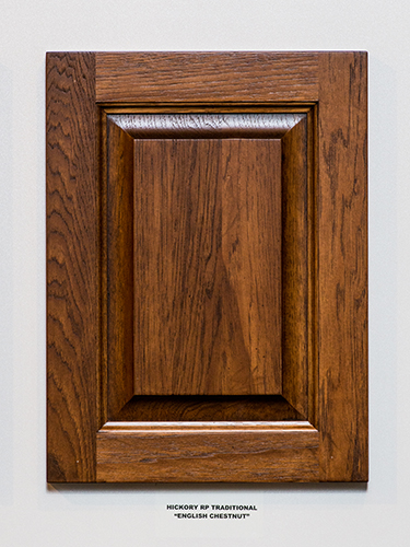 A hickory kitchen cabinet door, in the English Chestnut finish