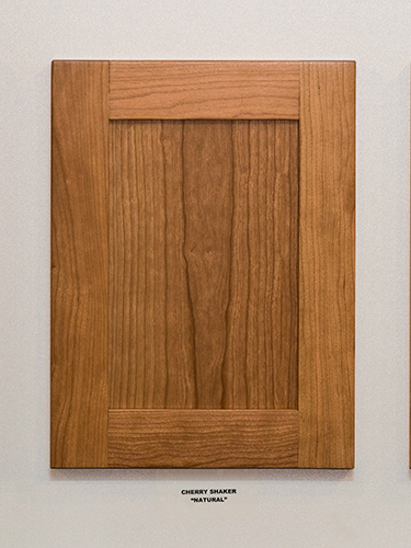 A cherry kitchen cabinet door, in the Natural finish